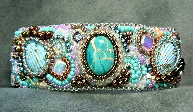 "There really isn't any of the namesake gem in this bead embroidery bracelet, but ""Aquamarine"" has the feeling of an undersea kingdom."