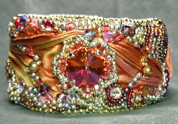 "With the sunrise colors in this bead embroidery cuff, the name had to reflect that. Thus came the name, ""Aurora's Jewels""."